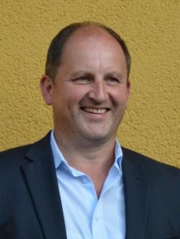Herr Gerhard Hauser